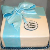 Blue Gift Covered in mmf, with gumpaste bow and ribbon. This was my first time working with gumpaste - it was fun!