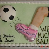 New_Soccer_Cake_May_2007_Resi.jpg This was done for the girls soccer team. Cake is 22x15 half choc, half vanilla. Iced in BC, Ball iscake, leg is rice krispie treat covered...