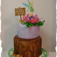 Tinkerbell Another Tinkerbell cake done for my daughter's friend. Cakes are covered in fondant with fondant and gumpaste details, edible image...