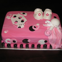 Pink And Brown Baby Girl Baby Shower Cake This is a chocolate and yellow cake. Everything on the cake is fondant except the bow on rattle.