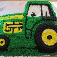 John Deere Cake I made this cake for a 6 year olds birthday party.The tires are made out of chocolate.