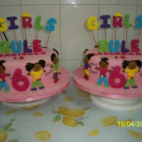 "Twin Girls Rule Made the cakes for twin girls that turned 6...10"" vanilla and strawberry cakes. Fondant and gum paste decoration.TFL."