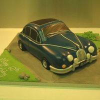 Mk2 Xk8 Jaguar Sugarpasted chocolate cake. For a Jaguar enthusiast. Took absolutely ages, I take far too long with car cakes.