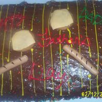 Father's Day Grill Chocolate cake, fudge frosting. The kids help me decorate it for dad with wilton icing writers. Hot dogs and cheeseburgers are from fondant...