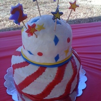 Circus Themed Birthday For a brother and sister (2 & 3 years old) birthday party with a circus theme. The decorations (stripes, stars, shapes) are fondant.