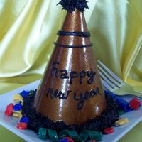 New Year's Eve Hat Chocolate cupcake, fondant accents.