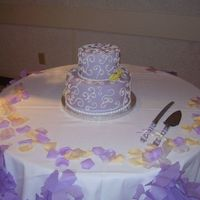 Lilac And Yellow Calla Cake This was a little two tier that went with the cupcakes for the same wedding. The callas are gumpaste and very non-professional, but you get...