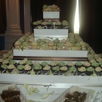 Sage, Chocolate And Ivory Cupcakes This was such an elegant, modern, pretty colour scheme. The cupcakes are all tied with little bows and topped with gumpaste flowers. DO NOT...