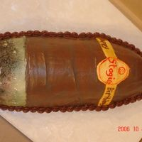 Cigar Yellow cake with Chocolate buttercream. The tip is white buttercream that is airbrushed and fondant label.