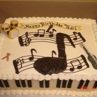 Musical Instruments Fondant piano keys for sides, drums, guitar, microphone and drum sticks. Buttercream icing