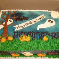 Halloween Birthday All buttercream halloween theme setting. Chocolate ghost and pumpkins on the sides