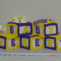 Lsu Baby Blocks Baby blocks in LSU colors. fondant booties. baby in blanket and letters. Buttercream icing