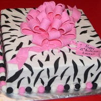 Zebra Striped Birthday Cake iced in buttercream, stripes are fondant, bow is fondant/gumpaste