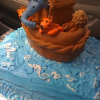 Noah's Ark Baby Shower Baseis buttercream, Ark and animals are all fondant. It is not asclean as i would have liked but the fondant was not cooperating.