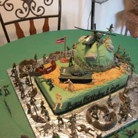 Army Cake buttercream with my son and hubby's placement of plastic soldiers. My son was very excited to be able to create his own battlefield in...