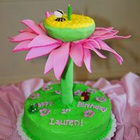 First Bloom I made this for my daughter's first birthday. bottom cake is buttercream, top cake is covered in fondant and resting on a cake tier (...