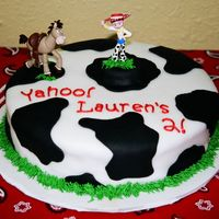 Yahoo Cowgirl! white fondant with black spots, buttercream grass border and writing