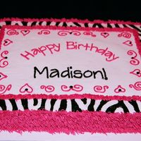 "Zebra Shag used grass tip to make hot pink ""shag"" and then filled in with zebra border. all buttercream - very simple :)"