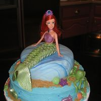 Ariel Birthday bottom cake is buttercream, top cake is fondant. my daughter and I made the sea creatures out of fondant and melted chocolate. we used...