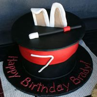 Brady's Magic Hat Cake Made for a Magician b-day party, fondX airbrushed black, all fondant accents.