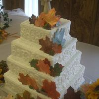Fall Square 4 Tier Wedding Cake This is a fall wedding cake I made using the sugar leafs I previously showed. It is a 4 tier wedding cake with butter cream frosting.