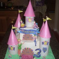 Fairy Princess Tinkerbell Castle cake is buttercream imprinted with pattern. The turrets, fairies/tinkerbell accents are gumpaste, edible rocks. this was my first castle...