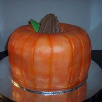 Pumpkin Cake Pumpkin made from 2 bundt cakes; Butter & German Chocolate. Iced in BC then airbrushed, drinking straw used to make indentions, ice...