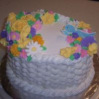 Basket W/flowers & Birds 2-layer Butter Cake with Buttercream icing. Color Flow birds, Royal Icing apple blossoms, violets, Victoria roses, daisies, daffodils,...