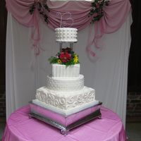 "Burton Wedding Cake WASC cake with buttercream icing; 14"" square with random swirls, 12"" round diamond pattern, 8"" square with stripes, and 6&..."