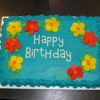 Tropical Birthday Cake 1/2 sheet butter cake w/buttercream and marshmallow flowers to resemble hibiscus