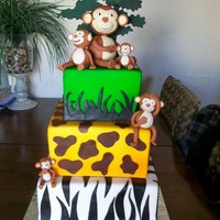 Monkey Babies Vanilla cake with all butter buttercream and fondant icings. Monkeys are fondant and tree shadow topper is gum paste. (My version of a...