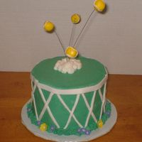 "Tennis Cake This is a small 6"" French Vanilla cake frosted in Butter cream with fondant accents."