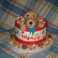 Puppy With Treats! 3-layer chai cake with cinnamon buttercream filling, covered with buttercream. Puppy is made out of rice crispies and covered with fondant...