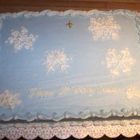 Emmanuel Celebration Snowy Sky This is the last of 3 cakes I did for the Emmanuel Celebration. It is egg-nog flavored, which I burned, covered in buttercream, brushed...