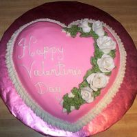 Another Valentine Cake Tiramisu-flavored cake (which mean coffee ice cream instead of oil) with pink fondant and white fondant roses with buttercream ruffle. This...