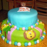 First Birthday This was the hardest cake I've ever done. The weird little monkey guy on top fell apart when I got it to the customer's house....