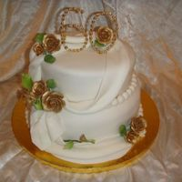 60Th Wedding Anniversary Fondant covered cakes with beaded 60 and GP roses painted with gold luster dust.