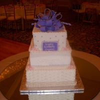 1763302_Orig.jpg Cake for 80th birthday. 12 inch, 10 inch and 8 inch square pans.