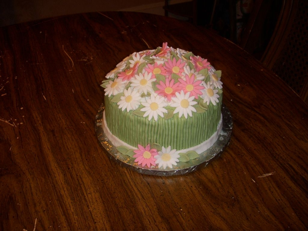 Daisys_009.jpg Daisy cake for my friend. Chocolate cake with coconut caramel cream filling.