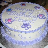 Basic Birthday Cake I wanted to decorate this cake very fancy, with brushed embroidery, but my niece was helping and this was our compromise. I also decorated...
