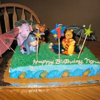 Pooh Bear Pool Party This was for my neice's first birthday, and she was in awe....teehee! White cake covered in buttercream. Purchased figures so they...