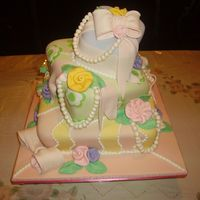 Topsy Turvy Bas Mitzvah Cake   Topsy turvy cake inspired by one collete peter's cakes. Fondant with fondant ribbons, bows and ribbon roses.