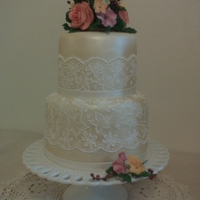 Lace Wedding Cake My first wedding cake - the bride wanted a cake that wasn't the standard size or design. I got my inspiration from a cake by Mich...