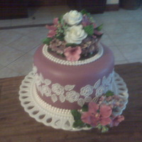 Single Tier Purple Wedding Cake  One tier almond cake covered in MMF and decorated with gumpaste orchids, roses and hydrangeas...(bride only wanted one tier). Sorry the...