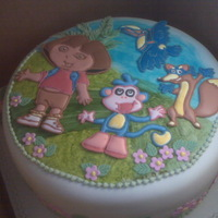 Dora The Explorer  Birthday cake for a six year old girl who requested a Dora the Explorer theme. Figures made in royal icing floodwork, cake covered in...