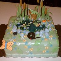 Reptile Pond Scene Chocolate cake with chocolate ganache filling. covered with MMF all pieces are MMF except for the cat tails and tall grass which are made...