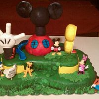 Mickey Mouse Clubhouse vanilla cake with chocolate ganache filling topped with buttercream and everything is covered in fondant. the clubhouse is att RCT covered...