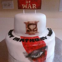 God Of War Cake Chocolate fudge cake with black cherry mousse filling. buttercream icing and MMF.
