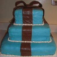 Tiffany Blue And Brown ok this is the first large cake i have made with fondant. It was hard to cover the larger pieces witht the fondant. The over all apperance...