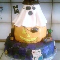 Halloween Pirate Cake I made this for my husbands work! All the managers at his work are dressing up as pirates so thats why its a Halloween pirate cake. I...